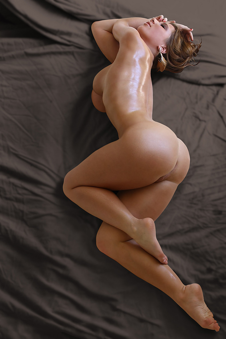 Naked booty lying on bed